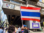 29 NOVEMBER 2013 - BANGKOK, THAILAND: Anti-government protestors march under the Nana BTS Station on Sukhumvit Road in Bangkok towards the US Embassy. Several thousand Thai anti-government protestors marched on the US Embassy in Bangkok. They blew whistles and asked the US to honor their efforts to unseat the elected government of Yingluck Shinawatra. The anti-government protestors marched through several parts of Bangkok Friday paralyzing traffic but no clashes were reported, even after a group protestors tried to occupy Army headquarters.         PHOTO BY JACK KURTZ