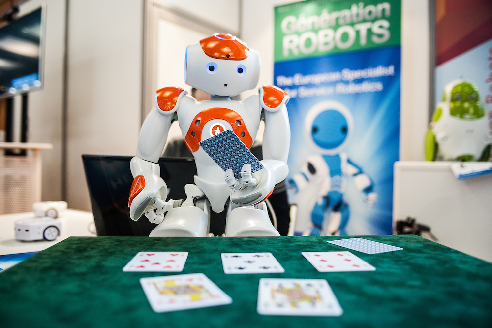 Lyon, France - 19 March 2014: NAO Robot by Aldebaran plays poker (software developed by Generation Robots) at Innorobo 2014, the 4th international trade show on service robotics.