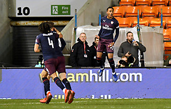 Arsenal's Joe Willock (right) celebrates scoring his side's first goal of the game during the Emirates FA Cup, third round match at Bloomfield Road, Blackpool.