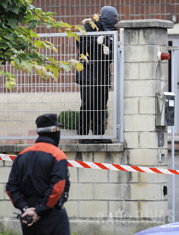 Basque police look for evidence next to the building of Basque journal El Correo, where separatist armed group ETA exploded off a bomb early on June 8, 2008, in the northern Spanish Basque village of Zamudio. No victims were reported.