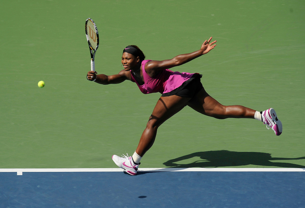 NEW YORK - SEPTEMBER 04: Serena Williams stretches to return a ball to Maria Jose Martinez Sanchez during day five of the 2009 U.S. Open at the USTA Billie Jean King National Tennis Center on September 4, 2009 in Flushing neighborhood of the Queens borough of New York City. (Photo by Rob Tringali) *** Local Caption *** Serena Williams