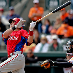 Mar 3, 2013; Sarasota, FL, USA; Philadelphia Phillies third baseman Michael Young (10) hits a two run homerunagainst the Baltimore Orioles scoring Cesar Hernandez (not pictured) during the top of the second inning of a spring training game at Ed Smith Stadium. Mandatory Credit: Derick E. Hingle-USA TODAY Sports