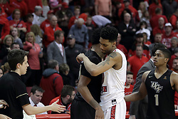 20 March 2017:  Phil Fayne(10) hugs Nick Banyard during a College NIT (National Invitational Tournament) 2nd round mens basketball game between the UCF (University of Central Florida) Knights and Illinois State Redbirds in  Redbird Arena, Normal IL