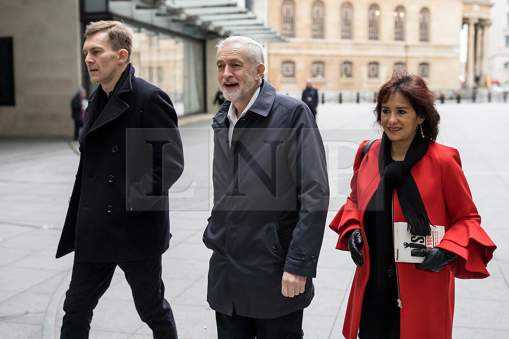 © Licensed to London News Pictures. 13/01/2019. London, UK. Leader of the Labour Party Jeremy Corbyn MP (C), his wife Laura Alvarez (R) and Seamus Milne (L) arrive at BBC Broadcasting House to appear on The Andrew Marr Show. Photo credit: Rob Pinney/LNP