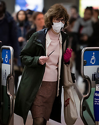 © Licensed to London News Pictures. 10/03/2020. London, UK. A woman wearing a medical mask while traveling through Westminster Underground Station in central London. New cases of the COVID-19 strain of Coronavirus are being reported daily as the government outlines it's plans for controlling the outbreak. Photo credit: Ben Cawthra/LNP