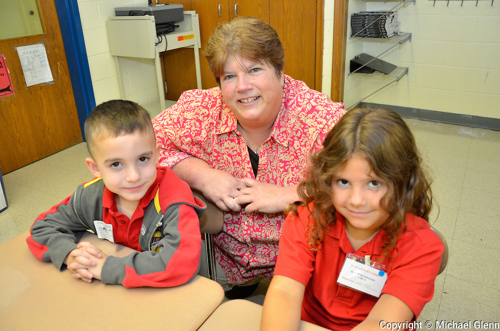 Jackson NJ, USA 04Sept2013 First day of school for students at Saint Aloysius, Principal  Elizabeth O'Connor with kindergarten students