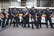 """New York City, NY, Sept 26th 2011, Police stand at the ready to do crowd control across from Liberty Square where protestors, part of the Occupy Wall Street movement have been camped out since Sept. 17th .Hundreds of demonstrators and activists affiliated with the """"Occupy Wall Street"""" movement have been living in Liberty Square in the finical district and have been marching on Wall Street protesting corporate greed and a corrupt political system since Sept. 17th. 80 people were arrested on Sept. 24th when the police clashed with the protesters near Union Square Park."""