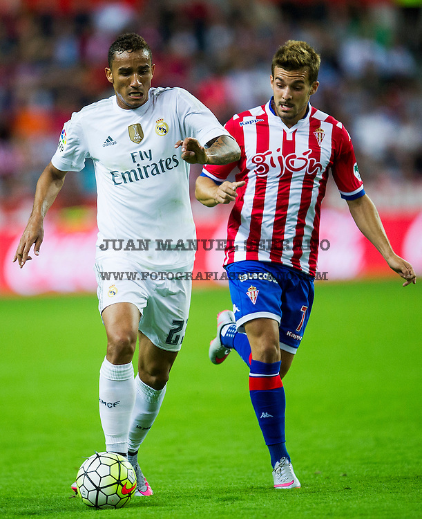 GIJON, SPAIN - AUGUST 23:  Danilo of Real Madrid duels for the ball with Juan Muniz of Real Sporting de Gijon during the La Liga match between Sporting Gijon and Real Madrid at Estadio El Molinon on August 23, 2015 in Gijon, Spain.  (Photo by Juan Manuel Serrano Arce/Getty Images)