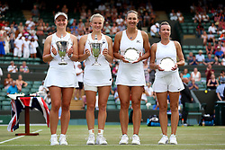Katerina Siniakova (second left) and Barbora Krejcikova (left) champions with their trophies after winning the Ladies Doubles and runners up Nicole Melichar and Kveta Peschke (right) on day twelve of the Wimbledon Championships at the All England Lawn Tennis and Croquet Club, Wimbledon. PRESS ASSOCIATION Photo. Picture date: Saturday July 14, 2018. See PA story TENNIS Wimbledon. Photo credit should read: Nigel French/PA Wire. RESTRICTIONS: Editorial use only. No commercial use without prior written consent of the AELTC. Still image use only - no moving images to emulate broadcast. No superimposing or removal of sponsor/ad logos. Call +44 (0)1158 447447 for further information.