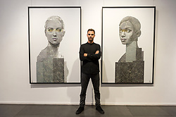 © Licensed to London News Pictures. 13/09/2018. London, UK. Artist NICK GENTRY poses with his work titled Human Connection (L) and Being 2 (R), 2018. Nick paints portraits on top of obsolete technological materials such as VHS cassettes and floppy disks that contain people's memories. His work is part of a joint exhibiton with South Korea artist SEO YOUNG-DEOK at the Opera Gallery. Photo credit: Ray Tang/LNP