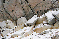 Detail view of boulders next to a cliff covered with a light dusting of snow, Enchantment Lakes Wilderness Area, Washington Cascades, USA.