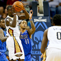 Dec 4, 2013; New Orleans, LA, USA; New Orleans Pelicans point guard Jrue Holiday (11) passes to small forward Al-Farouq Aminu (0) during the second half of a game against the Dallas Mavericks at New Orleans Arena.The Mavericks defeated the Pelicans 100-97. Mandatory Credit: Derick E. Hingle-USA TODAY Sports