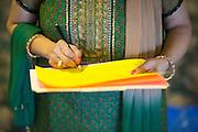 Mita Vora of Fremont judges the Diwali Rangoli competition based on theme, aesthetics, creativity, and time management at the Shreemaya Krishnadham Temple in Milpitas, California, on November 2, 2013. (Stan Olszewski/SOSKIphoto)