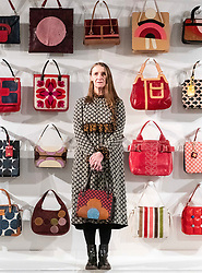Fashion designer, Orla Kiely, opens her exhibition Life in Pattern at the Dovecot Studios in Edinburgh on 7 February.<br /> <br /> The exhibition draws on Kiely's archives, offering visitors an unparalleled insight into her methods and concepts, with sketches, mood boards, and samples spanning 20 years of work.<br /> <br /> Pictured: Orla Kiely with a selection of her bags