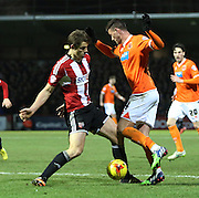 Gary Madine trying to win a penalty during the Sky Bet Championship match between Brentford and Blackpool at Griffin Park, London, England on 24 February 2015. Photo by Matthew Redman.