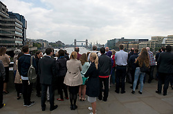 © Licensed to London News Pictures. 09/09/2015. London, UK. Crowds gather to watch A Royal River Salute taking place at Tower Bridge in London to mark the Queen becoming the longest reigning monarch in British history. The Queen will have reigned for 63 years and seven months , passing the record set by her great-great-grandmother Queen Victoria. Photo credit: Ben Cawthra/LNP