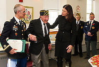 Lt. Col. Roy Hunter and Senator Kelly Ayotte present Pvt 1st Class Rosario Cadorette with two Bronze Stars and a Purple Heart for his service to our country during World War II at a presentation in his honor with the American Legion Post at the Belmont Mill on Wednesday afternoon.  (Karen Bobotas/for the Laconia Daily Sun)