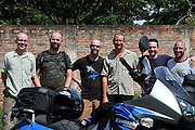 Men beginning a motorcycle adventure through Bolivia
