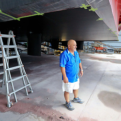 Vance Breaux, president at Breaux Brothers Enterprises Inc stands next to one of the supply vessels his company is building in Loreauville, Louisiana, U.S., on Friday, August 19, 2016.  Photographer: Derick E. Hingle/Bloomberg