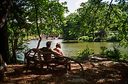 Couple on a bench in the Ramble near the Lake in Central Park