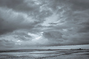 Cloudy skyscene and Norfolk coastal scene at Titchwell, North Norfolk, England, UK