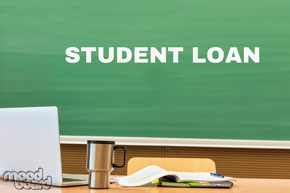 Student loan written on black board in classroom