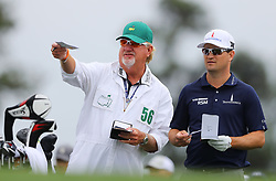 April 7, 2018 - Augusta, GA, USA - Zach Johnson, with his caddy, Damon Green, prepares to hit from the 1st tee during the third round of the Masters Tournament on Saturday, April 7, 2018, at Augusta National Golf Club in Augusta, Ga. (Credit Image: © Curtis Compton/TNS via ZUMA Wire)