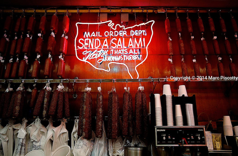 SHOT 5/6/14 10:29:33 AM - The Send a Salami sign at Katz's Delicatessen in New York City. Also known as Katz's of New York City, is a kosher style delicatessen restaurant located at 205 Houston Street, on the southwest corner of Houston and Ludlow Streets on the Lower East Side in Manhattan, New York City. New York is the most populous city in the United States and the center of one of the most populous urban agglomerations in the world—the New York metropolitan area. The city is referred to as New York City or the City of New York to distinguish it from the State of New York, of which it is a part. A global power city, New York exerts a significant impact upon commerce, finance, media, art, fashion, research, technology, education, and entertainment. New York City has often been described as the cultural and financial capital of the world. (Photo by Marc Piscotty / © 2014)