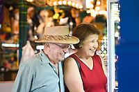 Senior couple watching window display, smiling