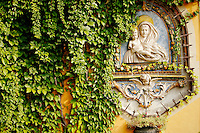Photo of a colorful depiction of the Virgin Mary and Jesus on an outdoor wall in Menaggio, Lake Como, Italy.