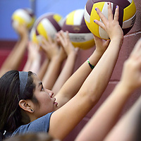 080514       Cayla Nimmo<br /> <br /> Talia Bowman practices het set against the wall during volleyball camp at Rehoboth Tuesday morning.