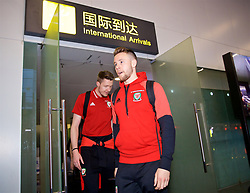 NANNING, CHINA - Monday, March 19, 2018: Wales' Chris Gunter and goalkeeper Wayne Hennessey arrive at Nanning International Airport for the 2018 Gree China Cup International Football Championship. (Pic by David Rawcliffe/Propaganda)
