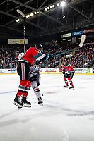 KELOWNA, BC - OCTOBER 12: Michael Farren #16 of the Kelowna Rockets hits a player of the Kamloops Blazers at Prospera Place on October 12, 2019 in Kelowna, Canada. (Photo by Marissa Baecker/Shoot the Breeze)