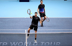 Bruno Soares (front) and Jamie Murray (back) in action during day seven of the Nitto ATP Finals at The O2 Arena, London.