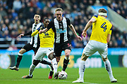 Sean Longstaff (#36) of Newcastle United on the ball under pressure from Shandon Baptiste (#16) of Oxford United during the The FA Cup match between Newcastle United and Oxford United at St. James's Park, Newcastle, England on 25 January 2020.