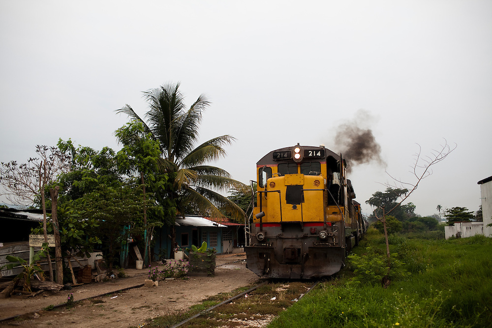 A freight train heads south through Tenosique, Tabasco.  Central American migrants ride on similar trains headed north from Tenosique as they try to make their way to the United States.  The trip for these migrants has become increasingly dangerous over the past several years as Mexico's drug war has raged and kidnappings and killings of migrants has increased.