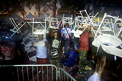 People scramble to find shelter as the crowd attending the WaWa Welcome America concert is caught by surprise by torrential downpour during the Independence Day celebrations on the Benjamin Franklin Parkway, in Philadelphia, PA, on July 4th, 2017.