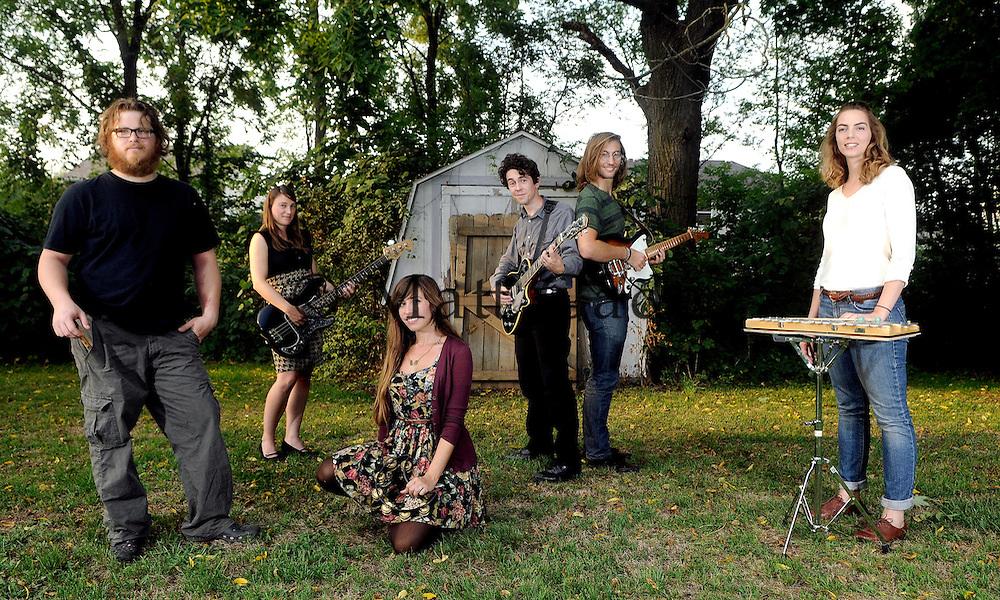 The band Glowfriends, from left; J.W. Hendrix (drums), Holly Klutts-Morris (bass), April Zimont (vocals, tamborine), Mark Andrew Morris (guitar, vocals), Adam Zimont (guitar) and Jenn Hendrix (vibes). .Date Shot 9-5-2012.(Matt Gade | MLive.com)
