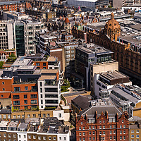 Aerial view over London England including Harrods Store. Harrods is a luxury department store located on Brompton Road in Knightsbridge, London. It is owned by the state of Qatar.