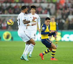Arsenal's Alexis Sanchez battles for the ball with Swansea City's Kyle Bartley  - Photo mandatory by-line: Joe Meredith/JMP - Mobile: 07966 386802 - 09/11/2014 - SPORT - Football - Swanswa - Liberty Stadium - Swansea City v Arsenal - Barclays Premier League