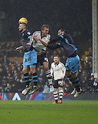Sheffield Wednesday defender Daniel Pudil just beating Fulham defender Dan Burn to the ball during the Sky Bet Championship match between Fulham and Sheffield Wednesday at Craven Cottage, London, England on 2 January 2016. Photo by Matthew Redman.