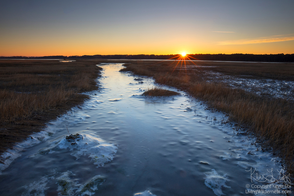 The sun rises over the ice-covered Assateague Channel, which separates the islands of Assateague and Chincoteague in eastern Virginia.