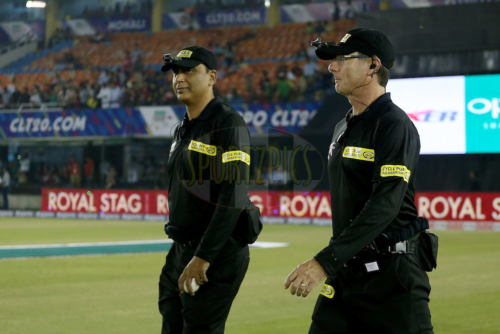 Umpires S Ravi and Ron Tucker waling out onto the field during match 2 of the Oppo Champions League Twenty20 between the Kings XI Punjab and the Hobart Hurricanes held at the Punjab Cricket Association Stadium, Mohali, India on the 18th September 2014. Photo by:  Jacques Rossouw / Sportzpics/ CLT20<br /> <br /> <br /> Image use is subject to the terms and conditions as laid out by the BCCI/ CLT20.  The terms and conditions can be downloaded here:<br /> <br /> http://sportzpics.photoshelter.com/gallery/CLT20-Image-Terms-and-Conditions-2014/G0000IfNJn535VPU/C0000QhhKadWcjYs