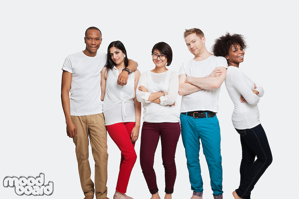 Portrait of multi-ethnic friends in casuals standing together over white background