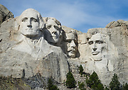 Mount Rushmore National Memorial, Keystone, South Dakota, USA. Sculptor Gutzon Borglum designed and oversaw the project 1927–1941, with help from his son, Lincoln Borglum. Mount Rushmore features 60-foot sculptures of the heads of four United States presidents: George Washington (1732–1799), Thomas Jefferson (1743–1826), Theodore Roosevelt (1858–1919), and Abraham Lincoln (1809–1865). South Dakota historian Doane Robinson conceived the idea of carving the likenesses of famous people into the Black Hills in order to promote tourism. Robinson's initial idea of sculpting the Needles was rejected by Gutzon Borglum due to poor granite quality and strong opposition from Native American groups. They settled on Mount Rushmore, and Borglum decided on the four presidents. Each president was originally to be depicted from head to waist, but lack of funding ended construction in late October 1941. Mount Rushmore is a batholith (massive intrusive igneous rock) rising to 5725 feet elevation in the Black Hills.