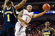 January 9, 2014: Deverell Biggs (1) of the Nebraska Cornhuskers with a lay up attempt against Glenn Robinson III (1) of the Michigan Wolverines at the Pinnacle Bank Arena, Lincoln, NE. Michigan defeated Nebraska 71 to 70.