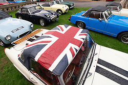 © Licensed to London News Pictures. 25/08/2018. Warwick, UK. The Midget & Sprite Club celebrated the 60th anniversary of the first Frogeye Sprite. Over 300 Sprites and Midgets arrived in Warwick to take part in a gala dinner and 100 mile drive through the Cotswolds. A patriotic British Sprite. Photo credit: Dave Warren/LNP