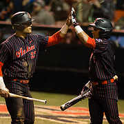 16 February 2018: San Diego State baseball opened up the season against UCSB at Tony Gwynn Stadium. San Diego State outfielder Chad Bible (23) scores on an rbi single in the fifth inning. The Aztecs beat the Gauchos 9-1. <br /> More game action at sdsuaztecphotos.com