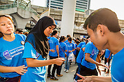 09 DECEMBER 2012 - BANGKOK, THAILAND:  Thai college students participate in an anti-corruption dance at the Bangkok Art and Culture Centre (BACC). About 1,500 Thai university students from 90 universities across Thailand attended the rally. The latest Corruption Perceptions Index survey by Transparency International listed Thailand at number 88 out of 176 countries surveyed. The level of corruption in Thailand is perceived to be on the same par as Malawi, Swaziland and Zambia. Thailand's ranking slipped from 80 last year. A series of surveys show that Thais increasingly view corruption as acceptable. A recent ABAC (Assumption Business Administration College, the forerunner to Assumption University, one of the most respected private universities in Thailand) poll reported that a majority (63 per cent) of Thai people hold the view that corruption in government is acceptable as long as they also benefit from it. A majority of young people under 20 now hold the same attitude. International Anti-Corruption Day has been observed annually, on the 9th December, since the passage of the United Nations Convention Against Corruption on 31 October 2003.       PHOTO BY JACK KURTZ