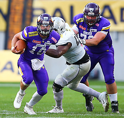 29.07.2017, Woertersee Stadion, Klagenfurt, AUT, AFL, Austrian Bowl XXXIII, Dacia Vikings Vienna vs Swarco Raiders Tirol, im Bild Kevin Burke (Dacia Vikings Vienna, #10, QB), Jermaine Guynn (Swarco Raiders Tirol, #44, DL) und Thomas Tippold (Dacia Vikings Vienna, #78, OL) // during the Austrian Football League Austrian Bowl XXXIII game between Dacia Vikings Vienna vs Swarco Raiders Tirol at the Woertersee Stadion, Klagenfurt, Austria on 2017/07/29. EXPA Pictures © 2017, PhotoCredit: EXPA/ Thomas Haumer